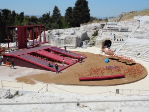 Greek Theatre with modern stage hands setting up a new performance